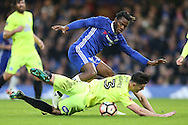 Andrew Hughes of Peterborough United attempting to stop  Michy Batshuayi of Chelsea. The Emirates FA cup, 3rd round match, Chelsea v Peterborough Utd at Stamford Bridge in London on Sunday 8th January 2017.<br /> pic by John Patrick Fletcher, Andrew Orchard sports photography.