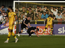 Port Vale's Ben Garrity (second right) shows his dejection after scoring an own goal during the Sky Bet League Two match at Borough Sports Ground, Sutton. Picture date: Saturday October 9, 2021.