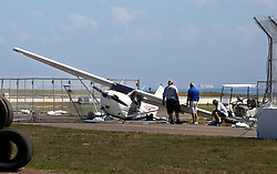 March 1, 2017 - St. Petersburg, Florida, U.S. - SCOTT KEELER   |   Times.A small Cessna airplane crashed at Albert Whitted Airport, Wednesday, 3/1/17 near the course of the upcoming Firestone Grand Prix of St. Petersburg. The student pilot was uninjured in the crash. (Credit Image: © Scott Keeler/Tampa Bay Times via ZUMA Wire)