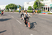 Cyclists rise through a road blocked to cars in a section of Connaught Place during a Raahgiri Day. Raahgiri Day is India's first sustained car-free citizen initiative that started in Gurgaon but has since spread across India. Here, Connaught Place is closed to traffic and community events are held. New Delhi, India
