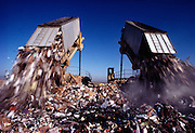 Dueling Garbage Trucks simultaneously unload in a California Dump.