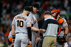 May 23, 2018 - Houston, TX, U.S. - HOUSTON, TX - MAY 23: San Francisco Giants starting pitcher Jeff Samardzija (29) is being looked at by team trainer after being hit by the ball in the third inning during MLB baseball game between the Houston Astros and the San Francisco Giants on May 23, 2018 at Minute Maid Park in Houston, Texas. (Photo by Juan DeLeon/Icon Sportswire) (Credit Image: © Juan Deleon/Icon SMI via ZUMA Press)