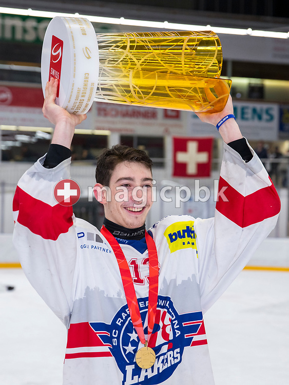 Rapperswil-Jona Lakers forward Jonas Graetzer poses with the Swiss Champion trophy after winning ice hockey game 4 of the Elite B Playoff Final between EHC Chur Capricorns and Rapperswil-Jona Lakers in Chur, Switzerland, Friday, March 16, 2018. (Photo by Patrick B. Kraemer / MAGICPBK)