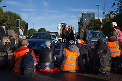 © Licensed to London News Pictures.  04/10/2021. London, UK. Insulate Britain protesters are seen blocking the A12 Blackwell Tunnel Northen Approach in east London. Photo credit: Marcin Nowak/LNP