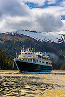 Un-Cruise small cruise ship Wilderness Explorer sailing out of Takatz Bay, Baranof Island, Inside Passage, Southeast Alaska USA.