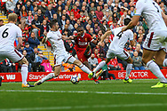 Daniel Sturridge of Liverpool © shoots at goal but sees his effort saved. Premier League match, Liverpool v Burnley at the Anfield stadium in Liverpool, Merseyside on Saturday 16th September 2017.<br /> pic by Chris Stading, Andrew Orchard sports photography.