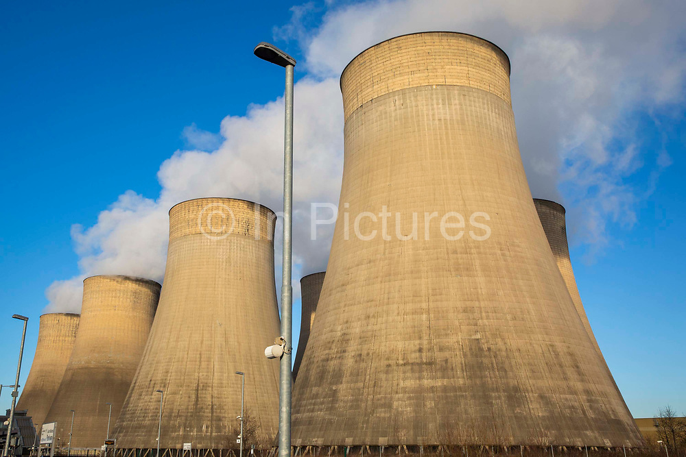 Smoke and steam bellows from the chimneys and cooling towers of Ratcliffe-on-Soar coal fired power station, owned and operated by Uniper at Ratcliffe-on-Soar in Nottinghamshire, England. The plant emits 8–10milliontonnes of CO2 annually. It has a generating capacity of 2,116MW,  enough electricity to meet the needs of approximately 2million homes.