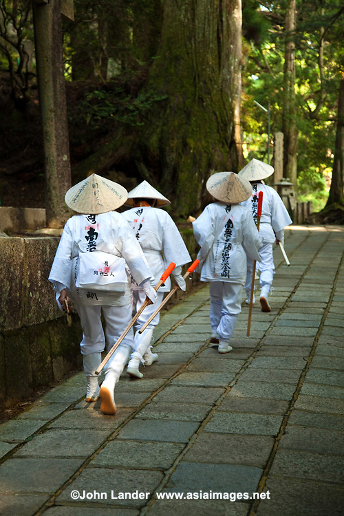 Henro, or Japanese Buddhist pilgrims, making their way along the sacred trails of Koya-san.  Though the most famous trail in Japan is around Shikoku Island's 88 temples, Koya-san is another hot spot.  Nowadays it is common to undertake pilgrimages in stages, completing one cycle in a number of trips; many devotees repeat the pilgrimage - even hundreds of times. Some become so addicted to the sites and the route that they spend their entire lives on the road and end their pilgrimage only in death, a memorial stone marking the ending  of their life's journey.