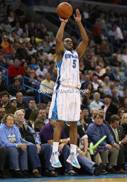 Mar 03, 2010; New Orleans, LA, USA; New Orleans Hornets guard Marcus Thornton (5) shoots against the Memphis Grizzlies during the second half at the New Orleans Arena. The Grizzlies defeated the Hornets 104-100. Mandatory Credit: Derick E. Hingle-US PRESSWIRE
