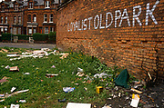A Loyalist wall and rubbish-strewn wasteground shows the dereliction of 1990s Belfast, northern Ireland. Rubbish and missing brickwork tell us of a city a decade after the Troubles when protestant fought catholic causes, a clash of religion and ideology with poor investment by a London-based government.