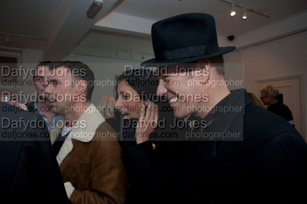SERENA REES; PAUL SIMONON, The  launch of Johnnie Shand Kydd's book Siren City. ( Photographs of Naples) Claire<br /> de Rouen books published  by Other Criteria. Charing Cross Rd. London. 30 November 2009