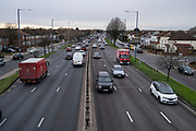 Traffic along the A40 Western Avenue with residential houses either side at Greenford on 4th December 2020 in London, United Kingdom. The A40 is one of the main roads in and out of the capital.