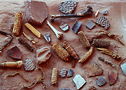 Assorted Ancestral Puebloan artifacts including corn cobs, turkey bones, potsherds and yucca twine, Junction Ruin, Grand Gulch, Grand Gulch Primitive Area, Bears Ears National Monument, Utah.