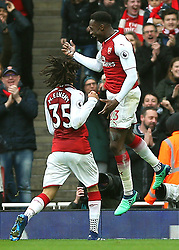 Arsenal's Danny Welbeck (right) celebrates after scoring his side's second goal of the game with team-mate Arsenal's Mohamed Elneny