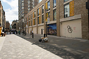 Empty shop fronts on the gentrified Berwick Street in Soho on 26th May 2021 in London, United Kingdom. As the coronavirus lockdown continues its process of easing restrictions, more and more people are coming to the West End as more businesses open.