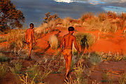 Kagalagadi Transfrontier Park, Xaus camp. Xaus, is owned by the San (Bushman) and Mier people who originally hunted here, and had a large tract of land in the park returned to them a few years ago. Kokai Maki teaching his young relation Andot Malgas hunting in the traditional manner.