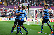 Christian Eriksen of Tottenham (c) celebrates  with Harry Kane (l) after he scores his teams 2nd goal to equalise at 2-2. Barclays premier league match, Swansea city v Tottenham Hotspur at the Liberty Stadium in Swansea, South Wales on Sunday 4th October 2015.<br /> pic by  Andrew Orchard, Andrew Orchard sports photography.