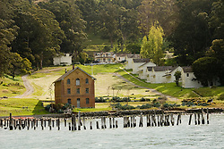 Camp Reynolds, Angel Island State Park, in San Francisco Bay, CA, California.  People disembark and picnic at Ayala Cove, then hike, bike, or tram perimeter road, with stops at Civil War era Camp Reynolds, and its restored officer house, or Spanish American War era Fort McDowell..Photo camari243-70335..Photo copyright Lee Foster, www.fostertravel.com, 510-549-2202, lee@fostertravel.com.
