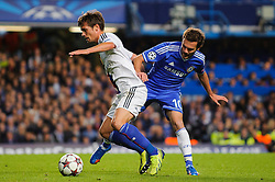 Basel Midfielder Valentin Stocker (SUI) is challenged by Chelsea Forward Juan Mata (ESP) during the second half of the match - Photo mandatory by-line: Rogan Thomson/JMP - Tel: 07966 386802 - 18/09/2013 - SPORT - FOOTBALL - Stamford Bridge, London - Chelsea v FC Basel - UEFA Champions League Group E