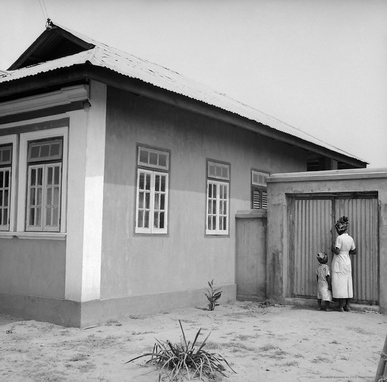 Woman and Child Outside of House, Lagos, Nigeria, Africa, 1937