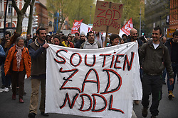 April 14, 2018 - Toulouse, France - The banner reads 'In support of NDDL' ZAD'. A demonstration in support of the ZAD (Zone to Defend ie Zone A Defendre) of Notre-Dame-Des-Landes took place in Toulouse, France, on 14 April 2018. The protest took place four days after the clearing operation by military launched by French President Macron. Many habitations in the ZAD were destroyed during the military operation in NDDL. The ZAD was established 10 years ago after the more than 50 years old project airport was relaunched. (Credit Image: © Alain Pitton/NurPhoto via ZUMA Press)