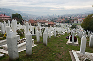 """Skyline of Sarajevo in early October, viewed from a cemetery (The Martyrs' Memorial Cemetery Kovači) holding the remains of some of the approximately 11,000 people who were killed during the siege of the city that lasted from 1992 to 1996. From the prosecutor's opening statement at the International Criminal Tribunal for the former Yugoslavia in its case against Stanislav Galić -- """"The siege of Sarajevo, as it came to be popularly known, was an episode of such notoriety in the conflict in the former Yugoslavia that one must go back to World War II to find a parallel in European history. Not since then had a professional army conducted a campaign of unrelenting violence against the inhabitants of a European city so as to reduce them to a state of medieval deprivation in which they were in constant fear of death. In the period covered in this Indictment, there was nowhere safe for a Sarajevan, not at home, at school, in a hospital, from deliberate attack."""""""