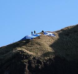 All Under One Banner Independence March, Edinburgh, Saturday 6th October 2018<br /> <br /> Pictured: Flags on Salisbury Crags<br /> <br /> Alex Todd | Edinburgh Elite media