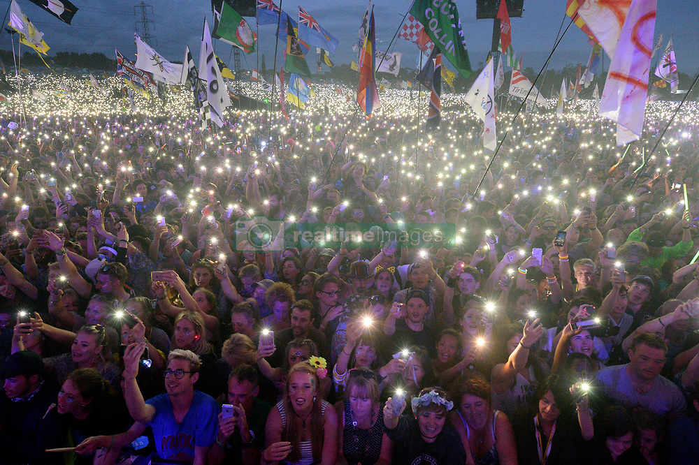Festivalgoers watch Ed Sheeran performing on the Pyramid Stage at Glastonbury Festival, at Worthy Farm in Somerset.