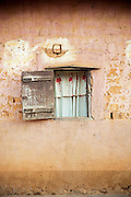 Small window to a house within the grounds of the Fons (local tribal leader) Palace, Bafut, Cameroon