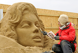 © Licensed to London News Pictures. 26/03/2013. Weston-super-Mare, UK.  The Sand Sculpture Festival at Weston-super-Mare beach.  This year's theme is Hollywood with sculptors from around the world working on film icons carved out of sand.  The festival opens to the public from 29 March.  26 March 2013..Photo credit : Simon Chapman/LNP