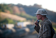 A Marine shaves as the sun sets during live-fire exercises for the 2nd Battalion, 5th Marine Regiment at Camp Pendleton.