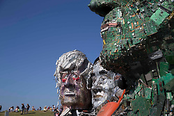© Licensed to London News Pictures.  13/06/2021. Hayle, UK. Visitors to Sandy Acres in Hayle Cornwall can look at 'Mount Recyclemore', which shows world leaders attending the G7 Summit. The sculpture was made by Joe Rush. Photo credit: Marcin Nowak/LNP