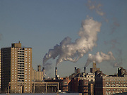 Smokestacks with residential buildings in the foreground New York City