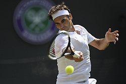 KEVIN ANDERSON BEATS ROGER FEDERER AT WIMBLEDON CHAMPIONSHIPS 2018.(180711) -- LONDON, July 11, 2018  Roger Federer of Switzerland hits a return during the men's singles quarter-final match against Kevin Anderson of South Africa at the Wimbledon Championships 2018 in London, Britain, on July 11, 2018. Kevin Anderson won 3-2. (Credit Image: © Stephen Chung/Xinhua via ZUMA Wire)