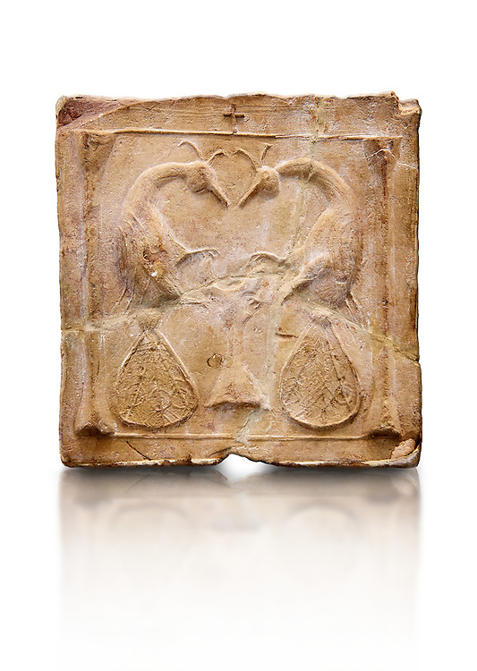 6th-7th Century Eastern Roman Byzantine  Christian Terracotta tiles depicting two Peacocks - Produced in Byzacena -  present day Tunisia. <br /> <br /> <br /> The patterns of peacock tails contain round decorations. These were seen to be the symbolic eyes of omnipotence and often ascribed to the Archangel Michael. The peacock's feather is sometimes associated with St. Barbara Also, The peacock, (due to an ancient myth that Peacock flesh did not decay), is seen as a symbol of immortality.<br /> <br /> These early Christian terracotta tiles were mass produced thanks to moulds. Their quadrangular, square or rectangular shape as well as the standardised sizes in use in the different regions were determined by their architectonic function and were designed to facilitate their assembly according to various combinations to decorate large flat surfaces of walls or ceilings. <br /> <br /> Byzacena stood out for its use of biblical and hagiographic themes and a richer variety of animals, birds and roses. Some deer and lions were obviously inspired from Zeugitana prototypes attesting to the pre-existence of this province's production with respect to that of Byzacena. The rules governing this art are similar to those that applied to late Roman and Christian art with, in the case of Byzacena, an obvious popular connotation. Its distinguishing features are flatness, a predilection for symmetrical compositions, frontal and lateral representations, the absence of tridimensional attitudes and the naivety of some details (large eyes, pointed chins). Mass production enabled this type of decoration to be widely used at little cost and it played a role as ideograms and for teaching catechism through pictures. Painting, now often faded, enhanced motifs in relief or enriched them with additional details to break their repetitive monotony.<br /> <br /> The Bardo National Museum Tunis, Tunisia.  Against a white background.