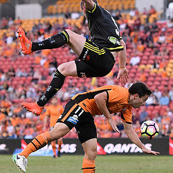 BRISBANE, AUSTRALIA - APRIL 16: Tommy Oar of the Roar and Ryan Lowry of the Phoenix collide during the round 27 Hyundai A-League match between the Brisbane Roar and Wellington Phoenix at Suncorp Stadium on April 16, 2017 in Brisbane, Australia. (Photo by Patrick Kearney/Brisbane Roar)