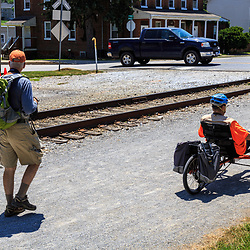 New Freedom, PA – June 25, 2016: Cyclists on the York County Heritage Rail Trail in New Freedom near PA-MD border.