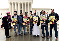 April 25, 2018 - Washington, District of Columbia, U.S. -  People gather on the street outside the U.S. Supreme Court as arguments in the Muslim country travel ban case, Trump v. Hawaii, are heard by the nine justices.(Credit Image: © Brian Cahn via ZUMA Wire)