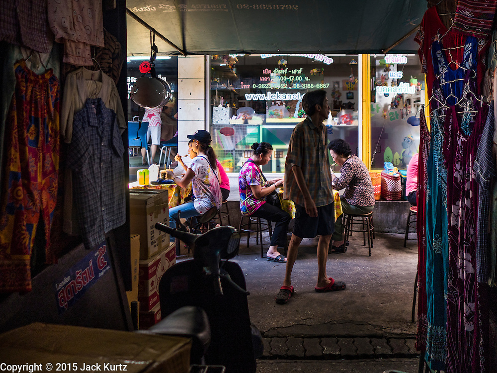 29 SEPTEMBER 2015 - BANGKOK, THAILAND:  Clothing stands in the market near the Saphan Lek market. Street vendors and illegal market vendors in the Saphan Lek area will be removed in the next two weeks as a part of an urban renewal project coordinated by the Bangkok Metropolitan Administration. About 500 vendors along Damrongsathit Bridge, popularly known as Saphan Lek, have 15 days to relocate. Vendors who don't move will be evicted. Saphan Lek is just one of several markets and street vending areas being closed in Bangkok this year. The market is known for toy and replica guns, bootleg and pirated DVDs and CDs and electronic toys.   PHOTO BY JACK KURTZ