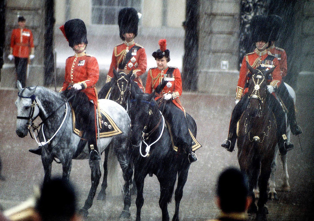 The Queen seen on her horse 'Burma' along with The Prince of Wales and Prince Philip in a heavy rain storm during the Trooping of The Colours ceremony,London in June 1982.Photograph by Jayne Fincher