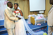 """Wedding of Refugees who escaped separately from Sudan and reunited in Israel, takes place at the """"Lift Up Your Head"""" church in South Tel Aviv. The Bride and Groom,"""