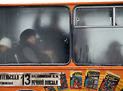 Nowosibirsk/Russische Foederation, RUS, 19.11.07: Ältere Frau schaut aus einem Stadtbus in der sibirischen Hauptstadt Nowosibirsk.<br /> <br />  Novosibirsk/Russian Federation, RUS, 19.11.07: Older woman is looking out of a city bus in the Sibirian capitol Novosibirsk.