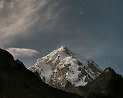 Moonlight, night shot of Baba Tangi (6513m / 21370feet). The traditional life of the Wakhi people, in the Wakhan corridor, amongst the Pamir mountains.