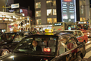 Taxi cabs in central Kyoto. Japan.