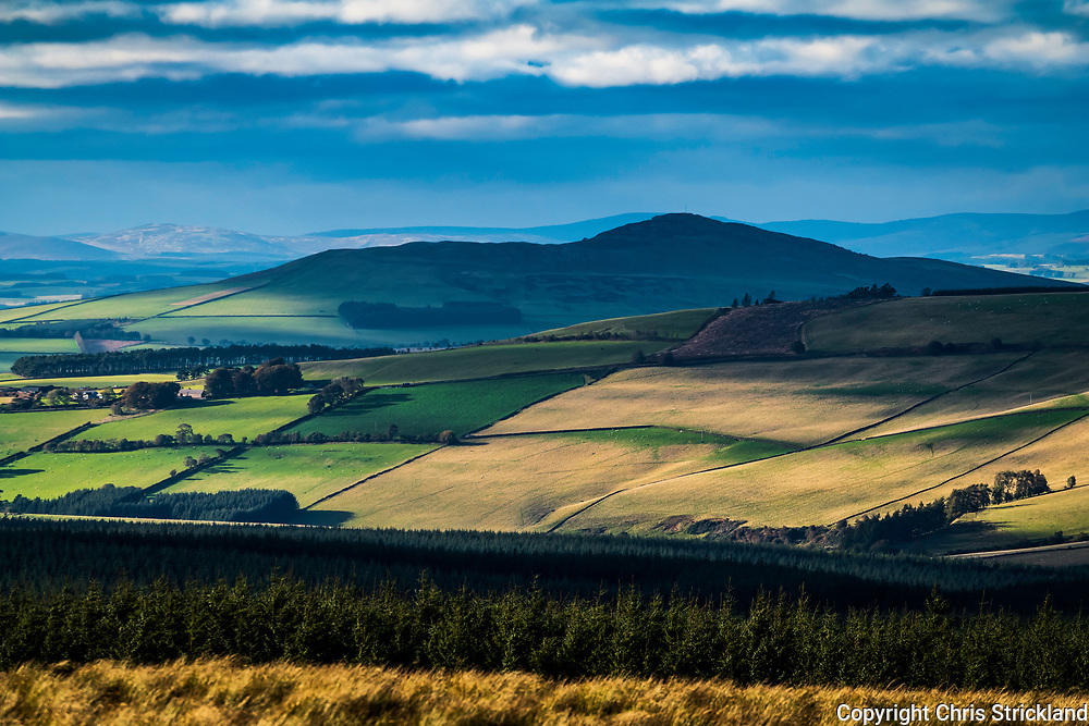 Chesters, Hawick, Scottish Borders, UK. 29th September 2018. Late afternoon light and shadows are blown across the countryside surrounding Ruberslaw hill near Hawick, viewed from the Carter Bar on the Anglo Scottish Border.