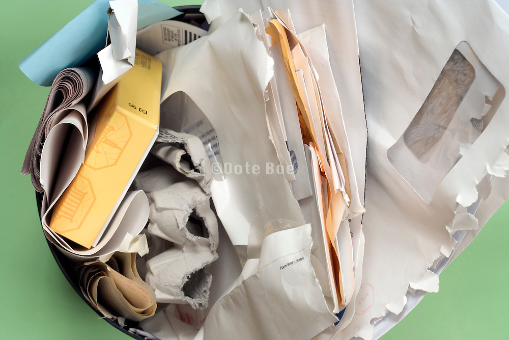 overhead view of small desk bin with paper