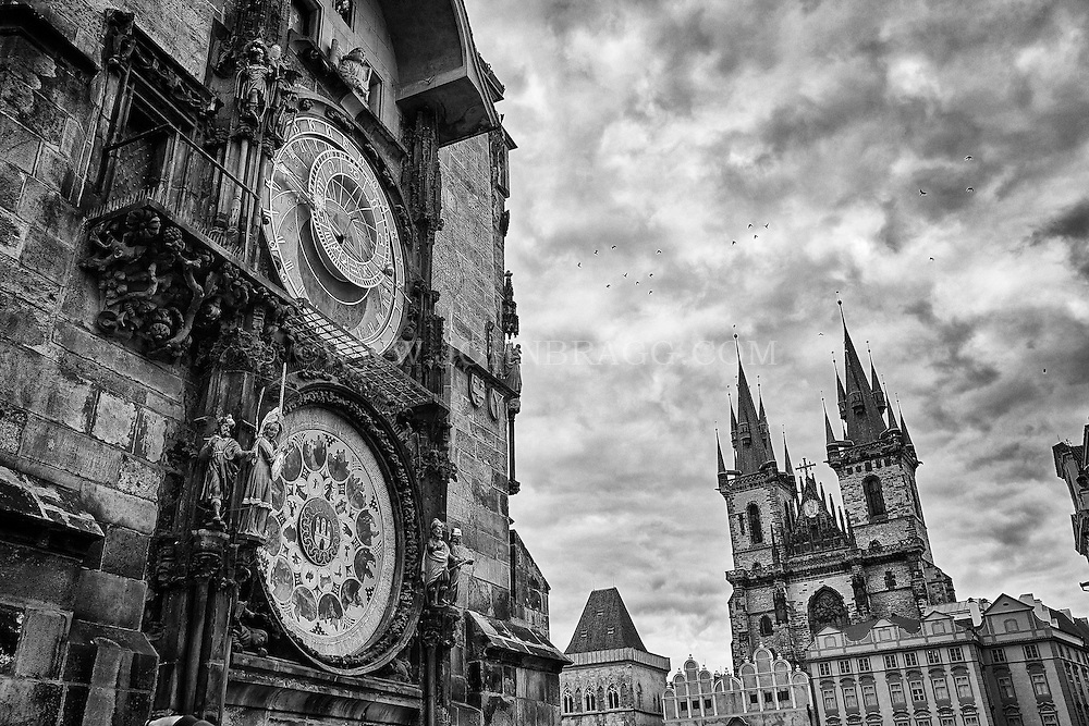 astronomical clock of the old town hall in the foreground with The Church of Our Lady Before Tyn in the background.
