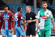 Scunthorpe United defender Rory McArdle (23) is shown the yellow card during the EFL Sky Bet League 1 match between Scunthorpe United and Plymouth Argyle at Glanford Park, Scunthorpe, England on 27 October 2018. Pic Mick Atkins