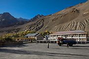 Indian truck drivers and their trucks, 23rd October 2009, Himachal Pradesh, India. The trucks drive along roads in this area that are often precarious, with vehciles seen clinging to the edge with a sheer cliff drop on the side. The region of Spiti and Kinnaur is a remote and tribal area of the Indian Himalayas near the Tibetan border.