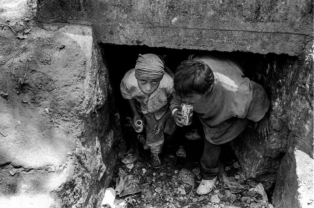 Homeless children living under the railroad tracks, Oaxaca, Mexico. 1996